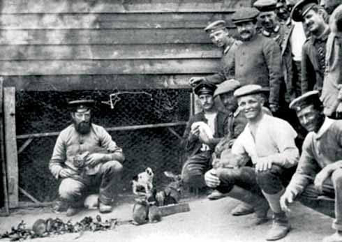Prisoners pose cheerfully with their pet rabbits. It is thought the animals were kept as pets rather than to be fattened up for eating.
