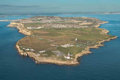 The beak-shaped southern tip of the Isle of Portland that is Portland Bill showing the three lighthouses and, further up, is the former Admiralty Underwater Weapons Establishment which is now known as Southwell Business Park and is home to a hotel and, from September 2016, will be the home of Isle of Portland Aldridge Community Academy, Portland's superschool