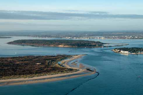 The eastern end of the 630-mile South West Coast Path is at South Haven point, just before the Sandbanks ferry on Studland. Opposite it is Sandbanks, while Brownsea Island and Poole Harbour sit behind the narrow crossing point.