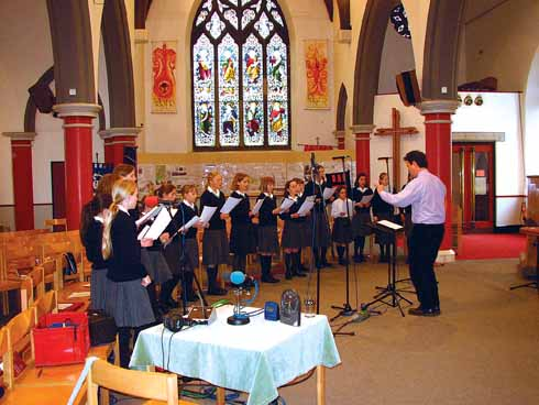 Simon conducting young Salisbury choristers for BBC Daily Service in Manchester