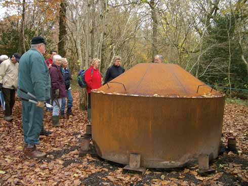 Charcoal burner at Bonsley Wood during a Climate Change field trip