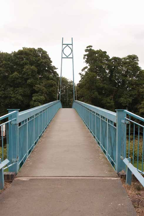The suspension bridge joining Blandford St Mary with the centre of town