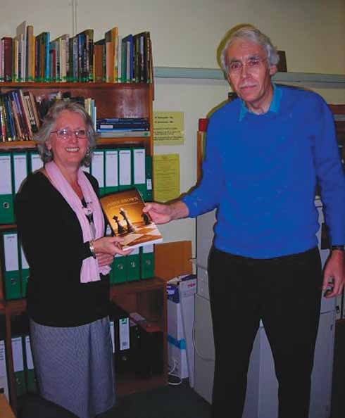 Author Brian Gosling presents a copy of his book about John Brown to Margaret Milree, assistant curator at Bridport Museum