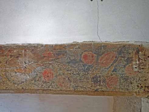 An enlargement of the painted beam above the fireplace in the Family Room
