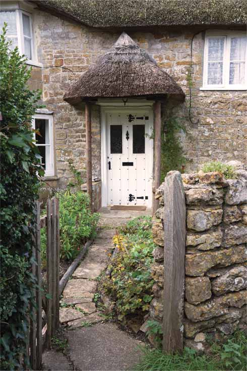 Even the porch gets its own thatched roof on this cottage