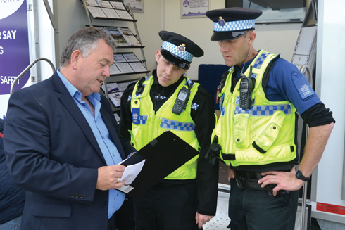 Martyn Underhill with two Police Community Support Officers on the PCC's stand in September last year
