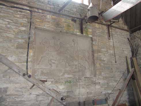 A relief, probably by Mary, in Portland stone backstage in the stable theatre and based on George Spencer Watson's 1922 painting Four Loves I Found, a Woman, a Child, a Horse and a Hound. Below is a list of men who built the stable in 1926.