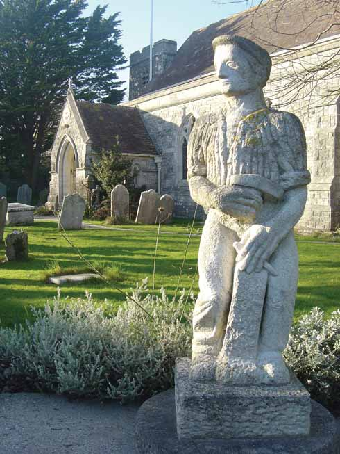 Purbeck Stonemason, Mary Spencer Watson's millennium commission for Langton Matravers, stands by St George's Church