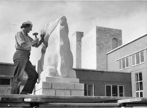 Mary puts the final touches to Eland, the figure she carved for Wyke Regis Primary School in 1952 (Herbert of Weymouth)