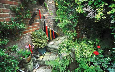 The garden is arranged in three paved patio 'rooms'