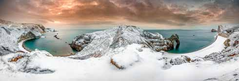 An extraordinary panoramic sweep of Man O'War Bay and Durdle Door in the snow