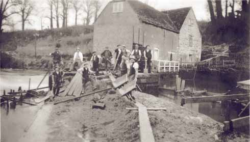 Men mending the damage after flooding