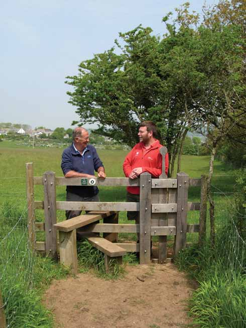 Jonathan Kershaw of the National Trust and Ian discuss stile renewal – each is tailor-made for their location