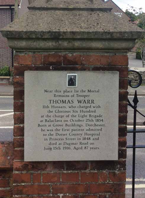 The memorial to Thomas Warr at the gate of Fordington Cemetery, where he was buried in a pauper's grave