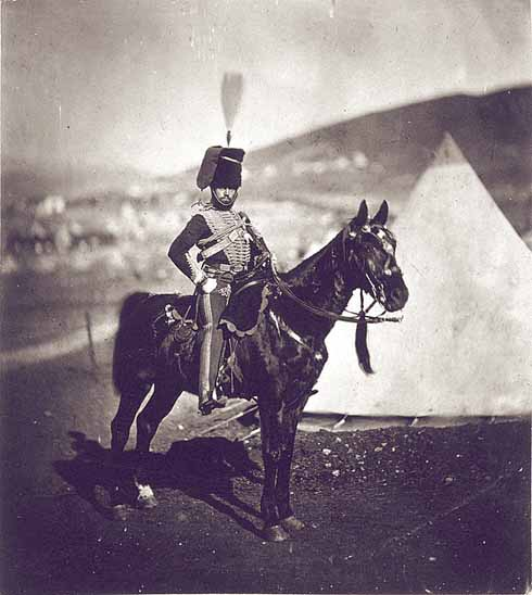 A cavalryman in the uniform of the 11th Hussars which impressed Tom so much that he decided to enlist