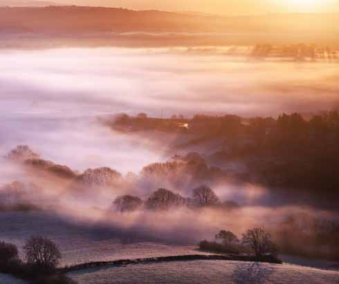 One of the properties of mist is its ability to catch shadows cast by solid objects in the image, especially when, as in this shot west of Bridport, the crisp and colourful morning light does a sculptor's job on the landscape