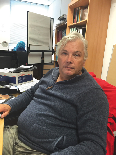 The unmistakable figure of Associate Professor Dave Parham out of his normal environment, but in his office at Bournemouth University