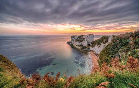 As this picture is looking almost due east for the sunrise at Old Harry it means it was taken at an equinox when the sun sits at compass points at daybreak (E), noon (S) and nightfall(W)
