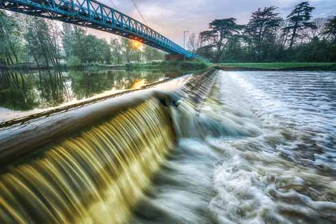 Suspension bridge over the Stour at Blandford, taken with an ultrawideangle lens very close to the flowing water