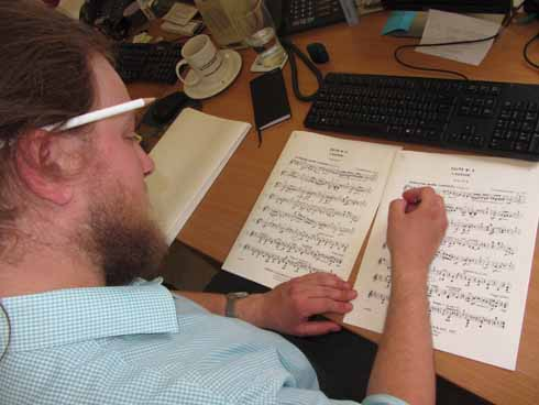 Alastair marking up a score at work in the BSO music library
