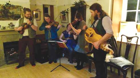 Alastair on hurdy-gurdy with members of the Band of the New Hardy Players at a private party