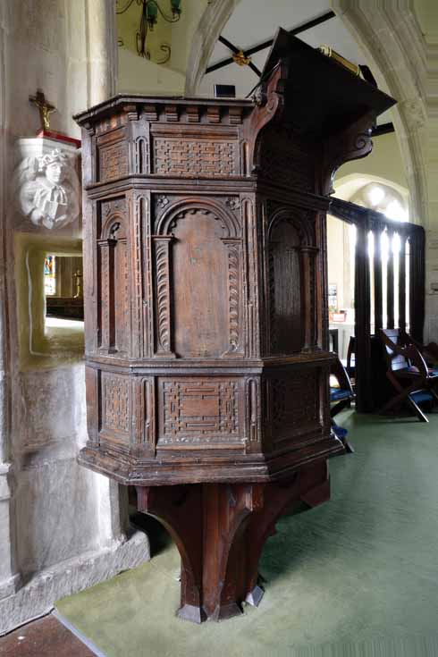 Atop a modern base in the parish church  of St Peter is a rather lovely Jacobean pulpit