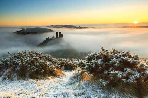 Corfe Castle from above the mist at daybreak. The one advantage to winter shooting for landscapes is that the early mornings are not quite as early as the summer ones. The picture was taken at the eminently civilised time of  twenty past eight.