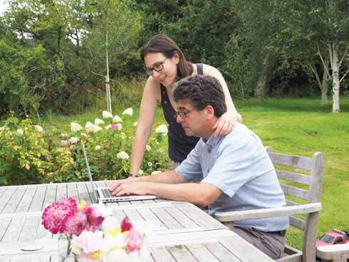 Natasha and David in the garden of their rural idyll... with superfast broadband