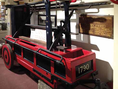 What 18th-century fire engines looked like: part of the Fire in Gillingham exhibition in the museum. The 1790 engine's solid wheels are for sturdiness not speed.