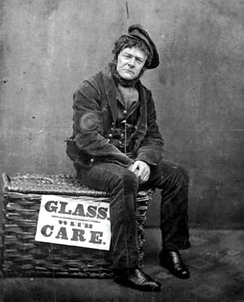 Sam Cowell in character for his song The Railway Porter