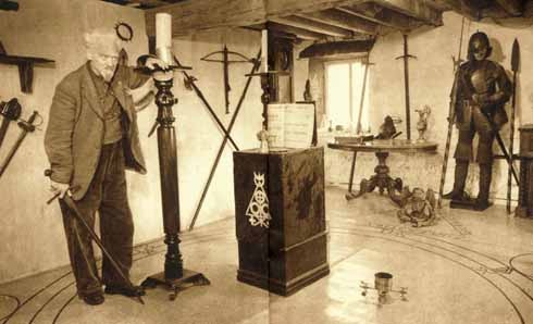 Gerald Gardner and his collection of weapons at the Witches Cottage, Bricket Wood
