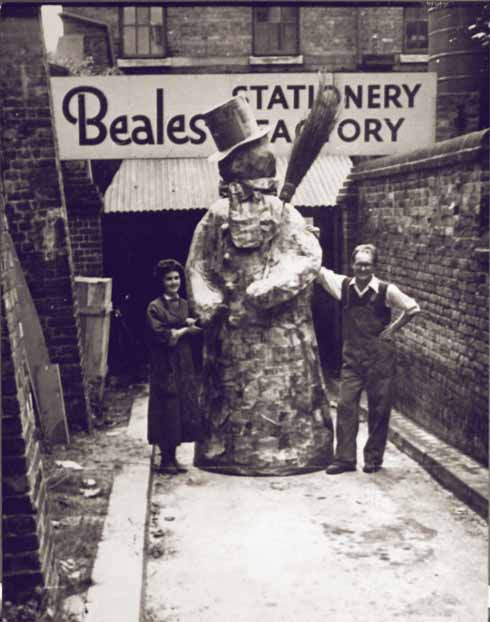 Workers at the Beales Stationery Factory taking time out to create a 12-foot-tall snowman for the Christmas parade