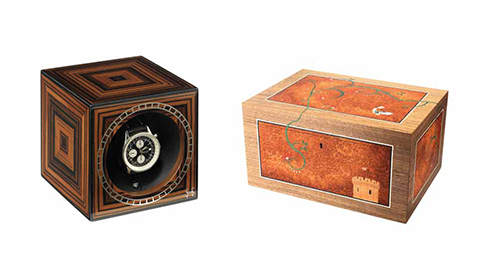 A watch winder cube and a jewellery box