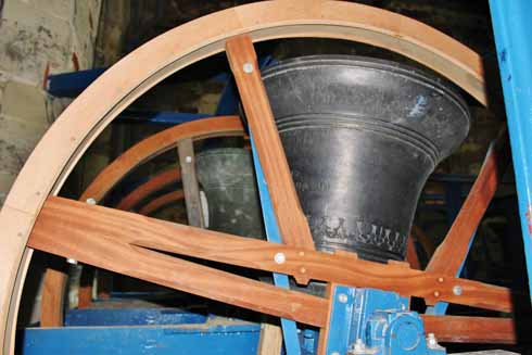 A bell at Wimborne Minster in its wooden wheel frame