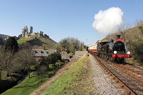 Swanage Railway's M7 class tank engine No. 30053 hauling a Dorsetman Sunday lunch train, steams past Corfe Castle
