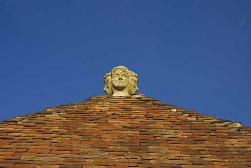 This rooftop finial is one of a number to be found in Shaftesbury. This one sits atop a building at the old Abbey.