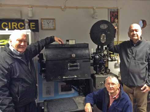 t Bob Dobson, Phil Stevens and John Thornley with one of the vintage projectors which is preserved in the Regent Cinema Museum. The one actually used today is a considerably more sophisticated piece of kit!