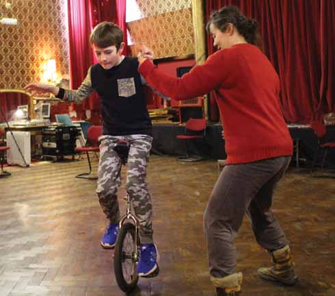 Director Niki McCretton helps 'Grub' get to grips with his unicycle