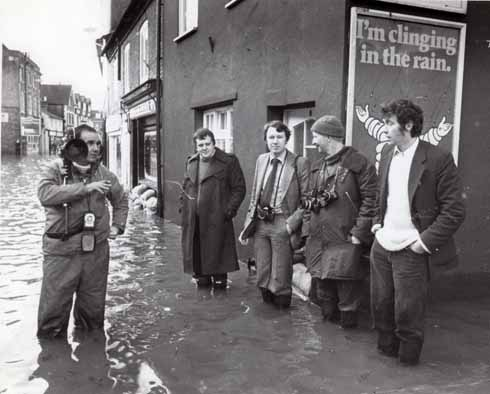 Roger Guttridge (far right) awaits the evacuation of an elderly man in Leigh Road, Wimborne, with (left to right) Southern Television cameraman David Davies, Wimborne Deputy Mayor Chris Bulteel and photographers Bob Richardson (Evening Echo) and Kevin Allison (Western Gazette)