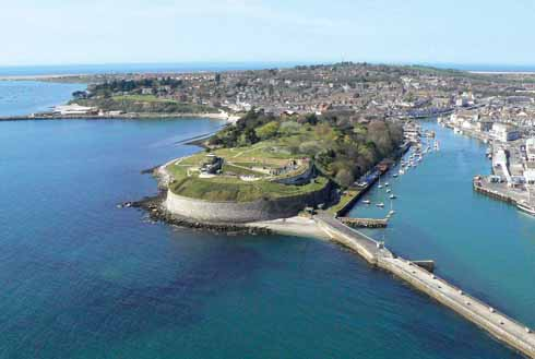 This aerial view shows how well-placed the Nothe Fort is to defend against any seaborne threat to Portland Harbour, to the left, or Weymouth Harbour, to the right