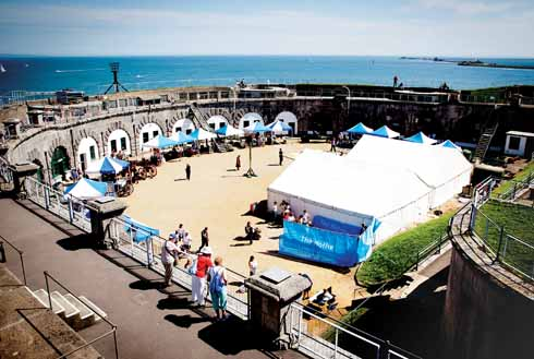 Special events such as this Victorian Fair keep the fort in the public eye and generate useful income. The breakwaters of Portland Harbour are visible in the distance.