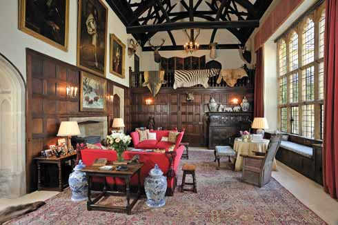 The Great Hall, with part of the magnificent roof, the panelling beyond which screens the passage, and the great window in the west wall, installed by Lady Victoria Herbert