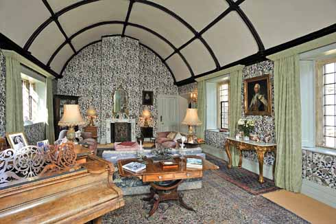 The Great Chamber, with its barrel roof and William Morris wallpaper