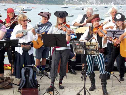 There'll be sea songs sung as folk musicians the Folk Orc also get into the pirate spirit